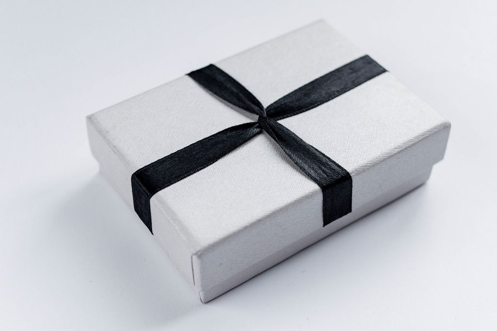 Small box tied with a black ribbon
