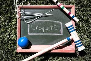 Small chalkboard with Croquet written on it