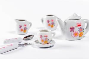 Small children ceramic tableware on white background