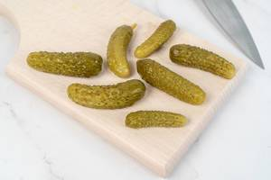 Small Pickles on the wooden board (Flip 2019)