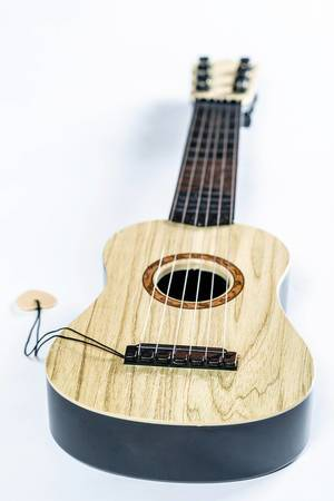 Small wooden guitar  Flip 2019