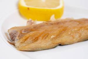 Smoked Mackerel fish closeup image with Lemon