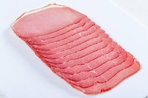 Smoked pork ham sliced on the slicer (Flip 2019)