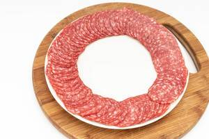 Smoked red Sausage arranged on the plate