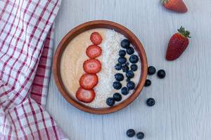 Smooothie bowl with Blueberries, Strawberries and Coconut Flake