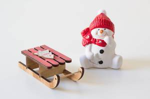 Snowman with sleighs