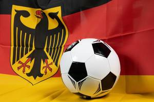 Soccer ball with Germany flag in background
