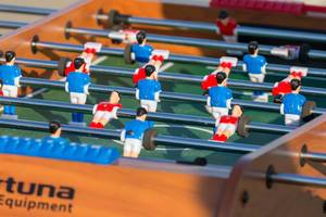 Soccer fans playing table football outdoors