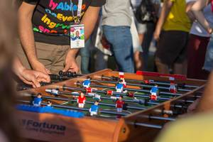 Soccer fans playing table football
