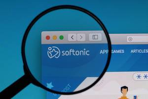 Softonic logo under magnifying glass