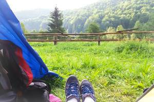Solo travels: hiking and backpacking with tent in the green mountains