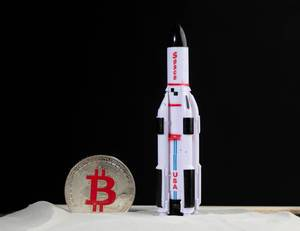 Space rocket with silver Bitcoin