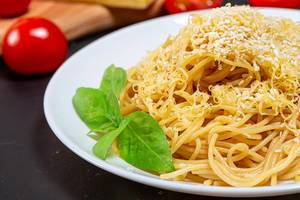 Spaghetti with grated cheese and sesame seeds close-up (Flip 2019)
