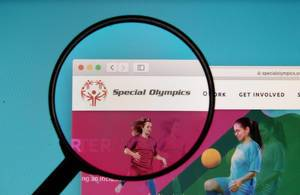 Special Olympics logo on a computer screen with a magnifying glass