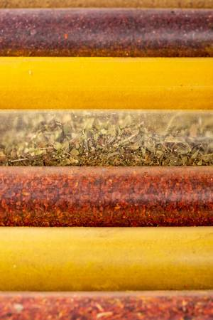 Spice and herbs background, collage of condiments