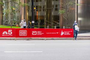 Sponsors ad on the side walk of Chicago Marathon: NBC Chicago Channel 5, Chicago Park District, Abbot World Marathon Majors and Bank of America