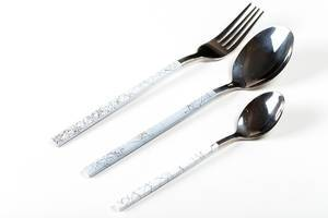 Spoon, fork and teaspoon on white background (Flip 2020)