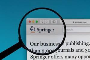 Springer logo under magnifying glass