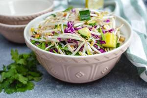 Sprout Asian Salad with Cucumber and fresh herb in a bowl  (Flip 2019)