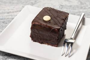 Square Chocolate Cream cake with fork