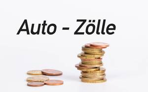 Stack of coins with text Auto - Zölle