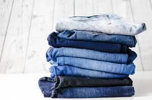 Stack of different jeans for men