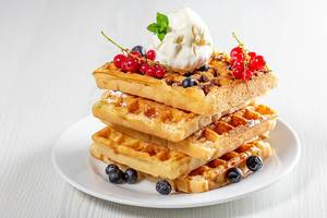 Stack of waffles with fresh berries and ice cream (Flip 2019)
