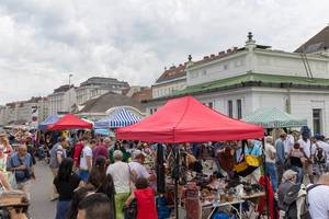 Stands with second-hand goods at the flea market at Naschmakrt in Vienna