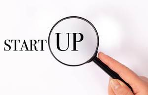 Start Up under magnifying glass