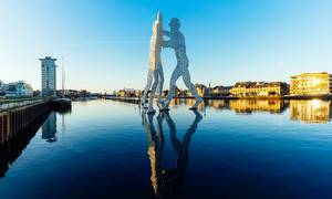 Statue of Molecule Man on river Spree