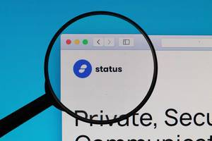 Status logo under magnifying glass