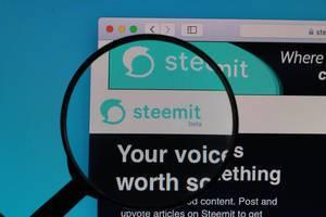 Steemit website under magnifying glass