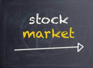 Stock market text on blackboard
