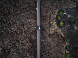 Straight road through a rocky landscape / Geradeaus durch eine felsige Landschaft