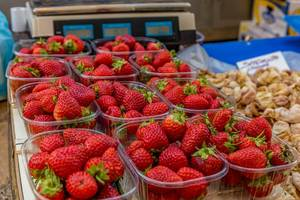 Strawberries and dried figs on marketplace