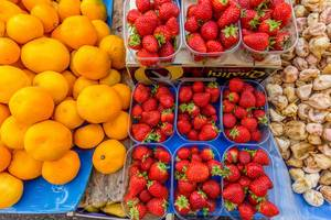 Strawberries, tangerines and dried figs on marketplace