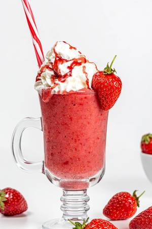 Strawberry smoothie with whipped cream and berry syrup