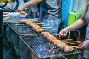 Street Food Barbecue Sticks at a Market in Saigon