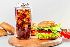 Street food concept - a glass of Coca Cola and hamburgers on a white wooden table (Flip 2019)