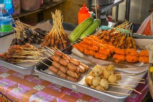 Street Food Vendor offering fried and grilled meat at Kasturi Walk in Kuala Lumpur