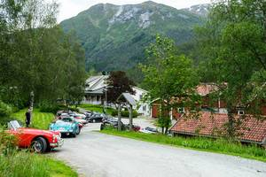 Street full of colorful antique collection cars in a hilly Norwegian town (Flip 2019)