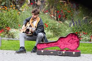 Street musician playing in a park in Munich