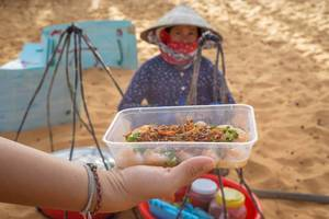 Streetfood Snacks in front of the Red Sand Dunes in Mui Ne, Vietnam  Flip 2019