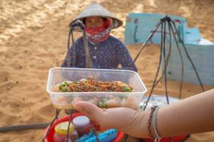 Streetfood Snacks in front of the Red Sand Dunes in Mui Ne, Vietnam