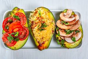 Stuffed avocado with different fillings