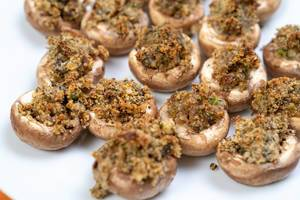 Stuffed Mushrooms with Cheese and Parsley on the plate