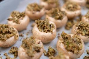 Stuffed Mushrooms with Cheese and Parsley ready for baking
