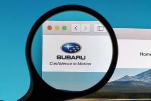 Subaru logo under magnifying glass