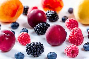 Summer background of fresh fruits and berries