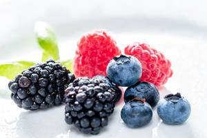 Summer berries of raspberry, blueberry and mulberry on white background (Flip 2019)